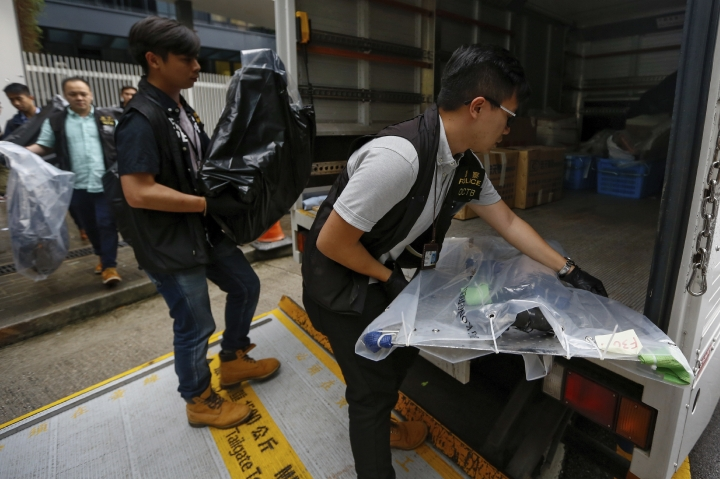 Policemen load boxes of evidence collected from the closed Legislative Council building in Hong Kong, Wednesday, July 3, 2019. A pro-democracy lawmaker who tried to stop Hong Kong protesters from breaking into the legislature this week says China will likely use the vandalizing of the building as a reason to step up pressure on the Chinese territory. (AP Photo/Andy Wong)