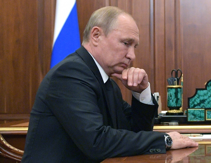 Russian President Vladimir Putin listens to Russian Defense Minister Sergei Shoigu during their meeting in the Kremlin in Moscow, Russia, Tuesday, July 2, 2019. A fire on one of the Russian navy's deep-sea submersibles killed 14 sailors, the Russian Defense Ministry said Tuesday without giving the cause of the blaze or saying if there were survivors. (Alexei Druzhinin, Sputnik, Kremlin Pool Photo via AP)