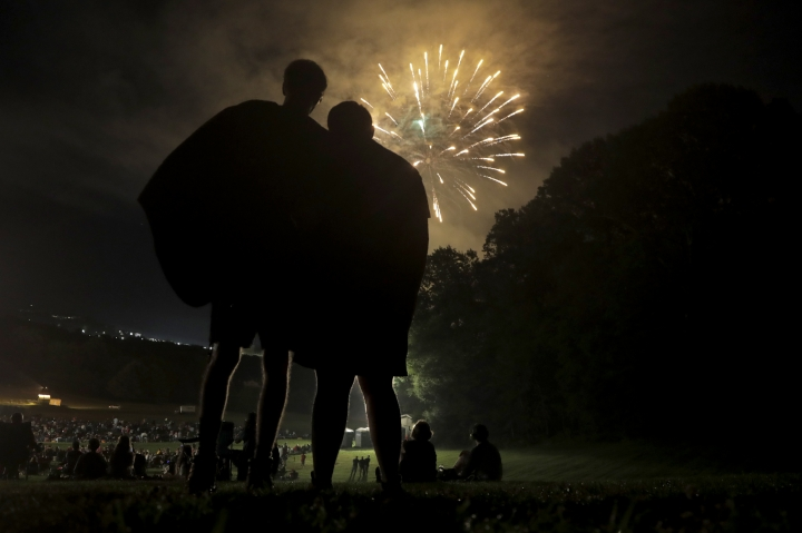 Michael Mays, left, of Cockeysville, Md., and Samuel Koch, of Reisterstown, Md., watch the firework display during the Baltimore County Independence Extravaganza, Wednesday, July 3, 2019, in Cockeysville. (AP Photo/Julio Cortez)
