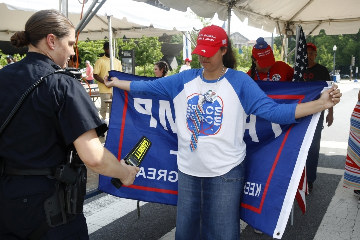 A supporter of President Donald Trump makes her way through a security checkpoint before Independence Day celebrations, Thursday, July 4, 2019, on the National Mall in Washington. (AP Photo/Patrick Semansky)
