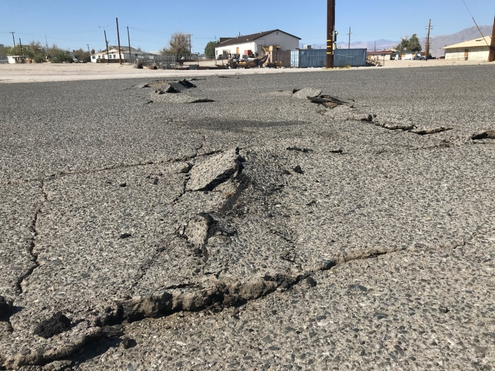 A road is damaged from an earthquake Thursday, July 4, 2019, in Trona, Calif. A strong earthquake rattled a large swath of Southern California and parts of Nevada on Thursday, rattling nerves on the July 4th holiday and causing some damage in a town near the epicenter, followed by a swarm of aftershocks. (AP Photo/Matt Hartman)
