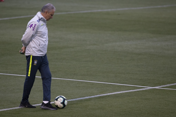 Brazil's coach Tite walks on the field during a practice session at the Granja Comary training center in Teresopolis, Brazil, Thursday, July 4, 2019. Brazil will play against Peru for the final of the Copa America on July 7. (AP Photo/Leo Correa)