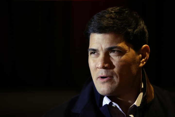 "FILE - In this Jan. 29, 2014, file photo, Tedy Bruschi speaks during an interview at the NFL Super Bowl XLVIII media center in New York. Former New England Patriots linebacker and current ESPN analyst Tedy Bruschi is recovering in a Massachusetts hospital after suffering a second stroke. His family says in a statement the 46-year-old suffered the stroke Thursday and immediately recognized the warning signs of arm weakness, face drooping and speech difficulties. Bruschi was admitted to Sturdy Memorial Hospital in Attleboro, where his family said Friday he was ""recovering well.""(AP Photo/Matt Slocum, File)"