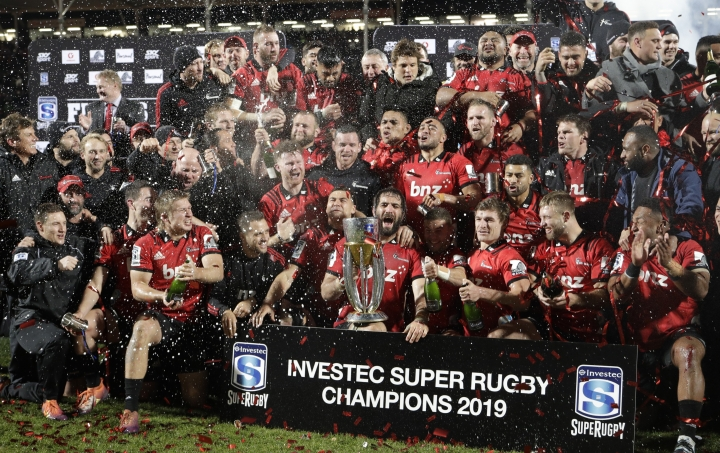 Crusaders players celebrate after defeating the Jaguares 19-3 to win the Super Rugby final b in Christchurch, New Zealand, Saturday, July 6, 2019. (AP Photo/Mark Baker)