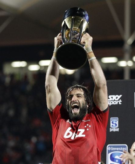Crusaders Samuel Whitelock holds the trophy aloft as he celebrates after defeating the Jaguares 19-3 to win the Super Rugby final b in Christchurch, New Zealand, Saturday, July 6, 2019. (AP Photo/Mark Baker)