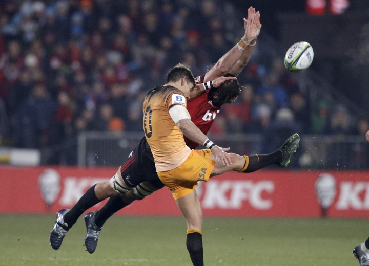 Crusaders Samuel Whitelock dives as he attempts to charge down the kick of Jaguares Joaquin Diaz Bonilla during the Super Rugby final between the Crusaders and the Jaguares in Christchurch, New Zealand, Saturday, July 6, 2019. (AP Photo/Mark Baker)