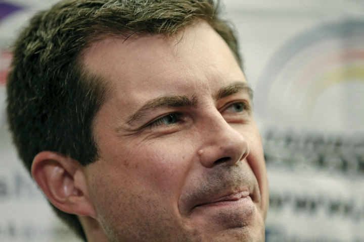 In this July 2, 2019 photo, Democratic presidential candidate and South Bend, Ind., Mayor Pete Buttigieg, listens as Rev. Jesse Jackson, not pictured, addresses reporters during a news conference at the Rainbow PUSH Coalition Annual International Convention in Chicago. Buttigieg has money _ far more than the mayor of South Bend, Indiana, expected to have at this stage of the Democratic presidential primary. Now he needs to turn that money into a formidable campaign to ensure his support from donors is matched by backing from voters. (AP Photo/Amr Alfiky)