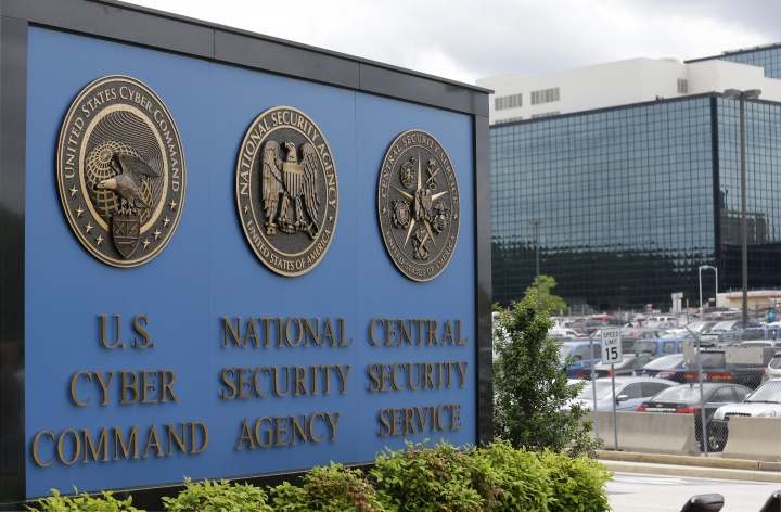 FILE - In this June 6, 2013 file photo, the sign outside the National Security Administration (NSA) campus in Fort Meade, Md. A high-profile raid at the home of an NSA contractor seemed to be linked to the devastating leak of U.S. government hacking tools. Three years later, the case is being resolved but whoever was behind the leak of the hacking tools remains a mystery with significant national security implications. (AP Photo/Patrick Semansky, File)