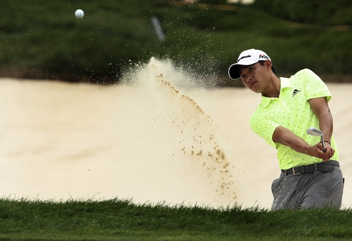 Collin Morikawa hits out of a bunker at 18 during the third round of the 3M Open golf tournament in Blaine, Minn., Saturday, July 6, 2019. (Jerry Holt/Star Tribune via AP)