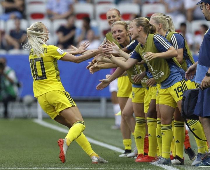 Sweden's Sofia Jakobsson, left, celebrates after scoring her side's second goal during the Women's World Cup third place soccer match between England and Sweden at Stade de Nice, in Nice, France, Saturday, July 6, 2019. (AP Photo/Claude Paris)