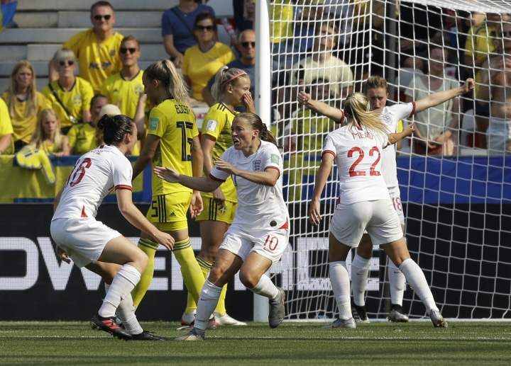 England players celebrate after England's Fran Kirby, centre, scored her side's opening goal during the Women's World Cup third place soccer match between England and Sweden at Stade de Nice, in Nice, France, Saturday, July 6, 2019. (AP Photo/Claude Paris)