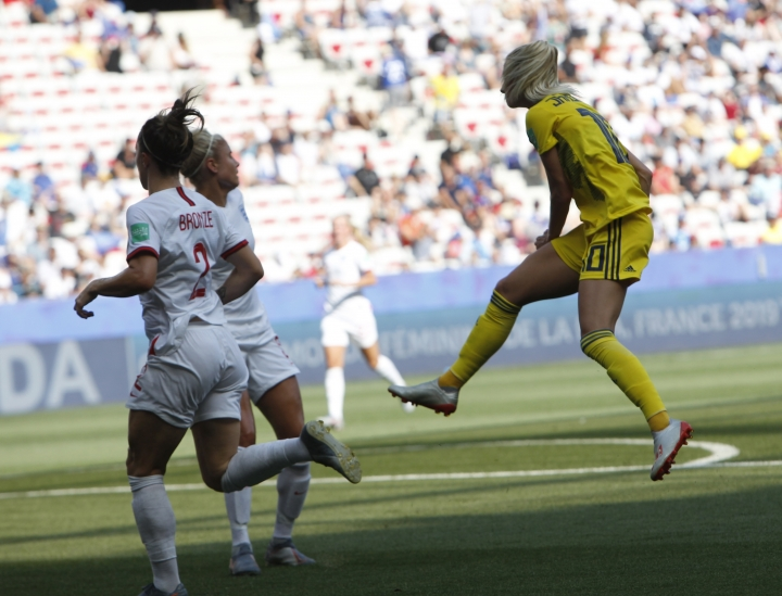 Sweden's Sofia Jakobsson, right, scores her side's second goal during Women's World Cup third place soccer match between England and Sweden at Stade de Nice, in Nice, France, Saturday, July 6, 2019. (AP Photo/Claude Paris)