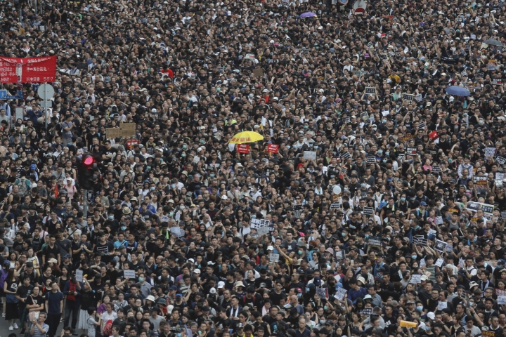 Protesters take part in a march in Hong Kong on Sunday, July 7, 2019. Thousands of people, many wearing black shirts and some carrying British flags, were marching in Hong Kong on Sunday, targeting a mainland Chinese audience as a month-old protest movement showed no signs of abating. (AP Photo/Kin Cheung)