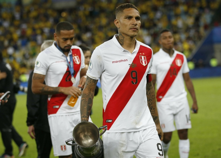 Peru's Paolo Guerrero walks with the second place trophy of the Copa America after Brazil defeated Peru 3-1in the final match of the Copa America at Maracana stadium in Rio de Janeiro, Brazil, Sunday, July 7, 2019. (AP Photo/Silvia Izquierdo)