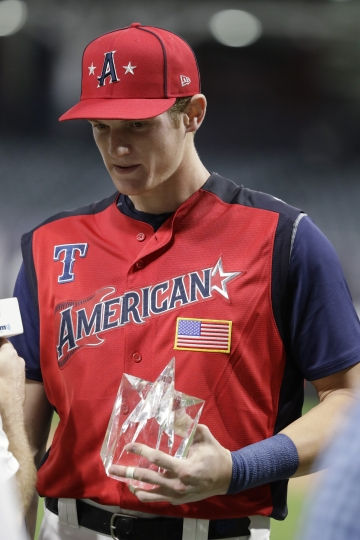 Sam Huff, of the Texas Rangers, holds the MVP trophy following the MLB All-Star Futures baseball game, Sunday, July 7, 2019, in Cleveland. The 90th MLB baseball All-Star Game will be played Tuesday. (AP Photo/Darron Cummings)