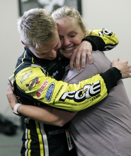 Justin Haley, left, gets a hug from his mother after he was declared the winner in a rain-shortened NASCAR Cup Series auto race at Daytona International Speedway, Sunday, July 7, 2019, in Daytona Beach, Fla. (AP Photo/John Raoux)
