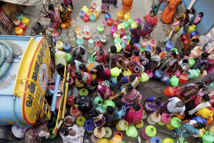 FILE- In this June 19, 2019, file photo, Indians stand in queues to fill vessels filled with drinking water from a water tanker in Chennai, capital of the southern Indian state of Tamil Nadu. With the government able to meet only 40% of water requirement, millions of people are depending on water tank trucks in the southern Indian state of Tamil Nadu because of an acute water shortage caused by drying lakes and deplete groundwater. (AP Photo/R. Parthibhan, File)