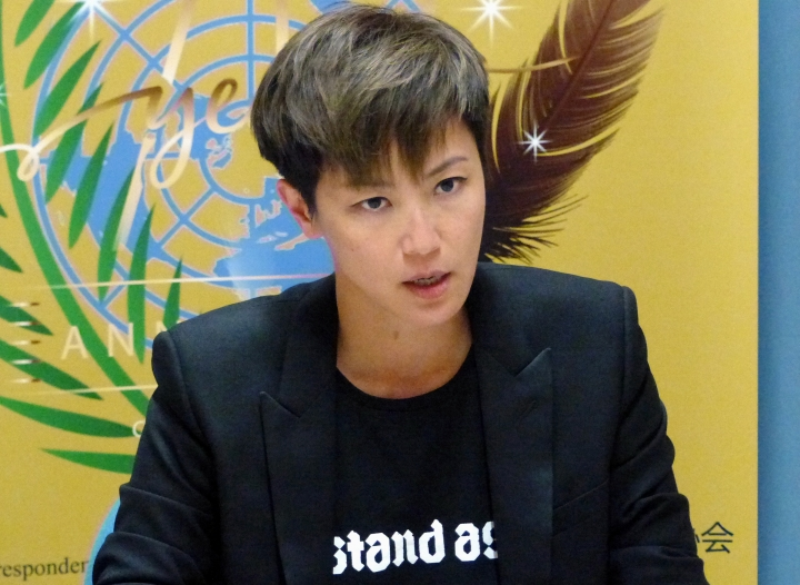 """Hong Kong pop singer Denise Ho speaks at the UN building in Geneva, Switzerland, Monday, July 8, 2019. Denise Ho has taken a message of defiance against China to the U.N.'s top human rights body, denouncing """"deceitful promises"""" by authorities and prompting a Chinese diplomat to interrupt her twice. The """"Cantopop"""" star asked the Human Rights Council on Monday whether it would suspend China as one of its 47 member states because of """"abuses"""" by Beijing, and whether the rights body would convene an urgent session to protect people in Hong Kong amid rising protests. (AP Photo/Jamey Keaton)"""