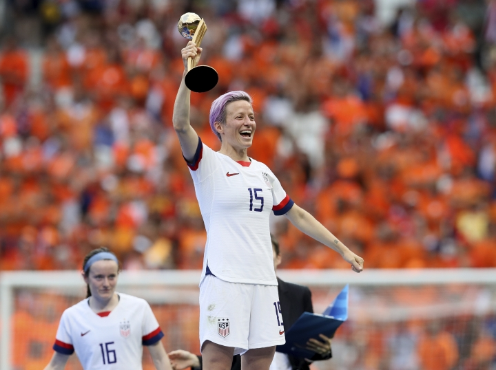 United States' Megan Rapinoe celebrates her team's victory with the trophy after the Women's World Cup final soccer match between US and The Netherlands at the Stade de Lyon in Decines, outside Lyon, France, Sunday, July 7, 2019. US won 2:0. (AP Photo/David Vincent)