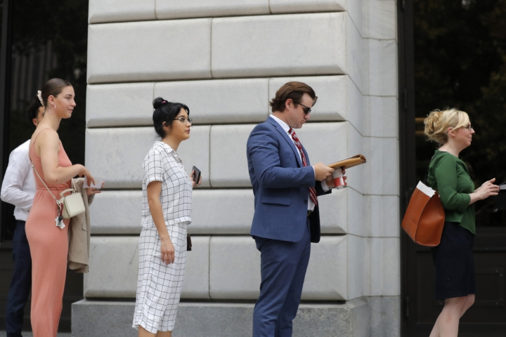 People wait in line to enter the 5th Circuit Court of Appeals to sit in overflow rooms to hear arguments in New Orleans, Tuesday, July 9, 2019. The appeals court will hear arguments today on whether Congress effectively invalidated former President Barack Obama's entire signature health care law when it zeroed out the tax imposed on those who chose not to buy insurance. A Texas judge in December ruled it was invalid, setting off an appeal by states who support the law. (AP Photo/Gerald Herbert)