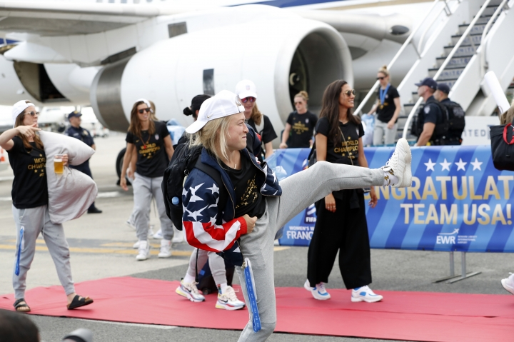 Members of the United States women's ju soccer team, winners of a fourth Women's World Cup, celebrate after arriving at Newark Liberty International Airport, Monday, July 8, 2019, in Newark, N.J. (AP Photo/Kathy Willens)