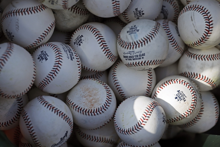 Baseballs are pictured as the American League players take batting practice before the MLB baseball All-Star Game, Tuesday, July 9, 2019, in Cleveland. Faced with a record onslaught of home runs and pitchers convinced baseballs are juiced, Commissioner Rob Manfred says the sport has been unable to find any changes in the manufacturing process. (AP Photo/John Minchillo)