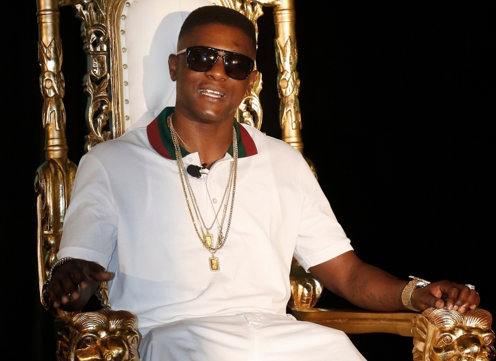 FILE - In this March 10, 2014, file photo, rapper Boosie Badazz appears at a news conference in New Orleans. The security guard who used pepper spray on a crowd including rapper Boosie Badazz says he did so as he was trying to get the group to leave and a man was trying to start a fight with him. In an interview with The Sun Herald, 55-year-old Glen Kerley denied allegations that he used racial slurs. He spoke with the newspaper after winning a $233,000 default judgment against the Louisiana rapper. (AP Photo/Bill Haber, File)