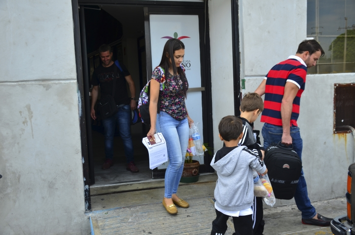 """Lucia Ascencio, of Venezuela, her husband and their two sons, arrive back to Nuevo Laredo, Mexico, as part of the first group of migrants to be returned to Tamaulipas state under the so-called Remain in Mexico program for U.S. asylum seekers, Tuesday, July 9, 2019. """"We hadn't thought that they were going to send us back,"""" said Lucia Ascencio. Her family was given a date in September to return for the next step in their process. (AP Photo/Salvador Gonzalez)"""