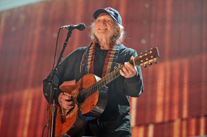 FILE - In this Sept. 19, 2015 file photo, Willie Nelson performs at Farm Aid 30 at FirstMerit Bank Pavilion at Northerly Island in Chicago. Nelson, John Mellencamp, Neil Young and Dave Matthews headline Farm Aid 2019 when the annual music and food festival visits Wisconsin's dairy country in September. Tickets for the Sept. 21 event at the Alpine Valley Music Theatre in East Troy, Wisconsin, go on sale Friday, July 12, 2019. (Photo by Rob Grabowski/Invision/AP, File)