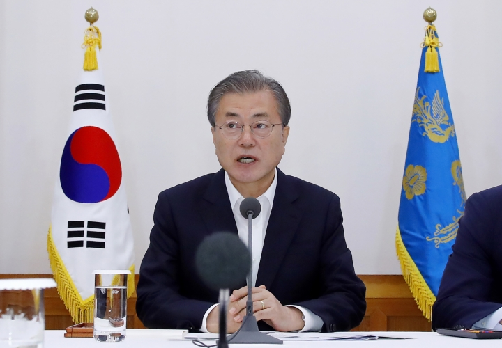 South Korean President Moon Jae-in speaks during a meeting with business leaders at the presidential Blue House in Seoul, South Korea, Wednesday, July 10, 2019. Moon criticized comments by Japanese officials who questioned the credibility of Seoul's sanctions against North Korea while justifying Tokyo's move to strengthen controls on high-tech exports to South Korea, which triggered a full-blown diplomatic dispute between the neighboring U.S. allies. (Bae Jae-man/Yonhap via AP)