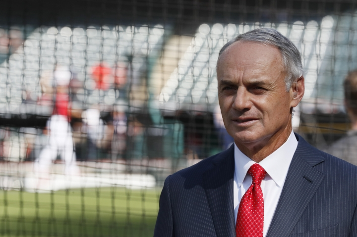 Commissioner Rob Manfred watches as the American League players warm-up for the MLB baseball All-Star Game, Tuesday, July 9, 2019, in Cleveland. (AP Photo/John Minchillo)