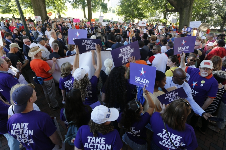 Anti gun demonstrators hold signs as they listen to speakers during a rally at the State Capitol in Richmond, Va., Tuesday, July 9, 2019. Governor Northam called a special session of the General Assembly to consider gun legislation in light of the Virginia Beach Shootings. (AP Photo/Steve Helber)