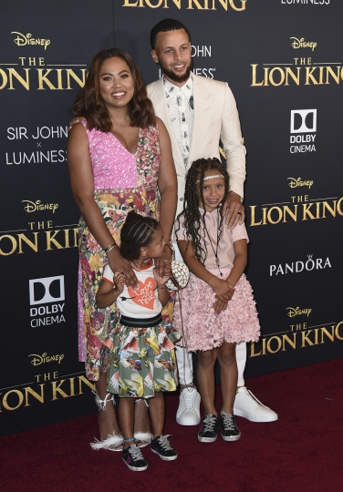 """NBA player Stephen Curry, of the Golden State Warriors, back right, Ayesha Curry, back left, and their children, from front row left, Ryan and Riley, arrive at the world premiere of """"The Lion King"""" on Tuesday, July 9, 2019, at the Dolby Theatre in Los Angeles. (Photo by Jordan Strauss/Invision/AP)"""
