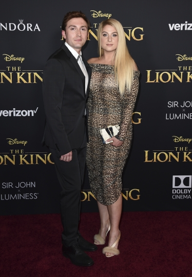"""Meghan Trainor, right, and Daryl Sabara arrive at the world premiere of """"The Lion King"""" on Tuesday, July 9, 2019, at the Dolby Theatre in Los Angeles. (Photo by Jordan Strauss/Invision/AP)"""
