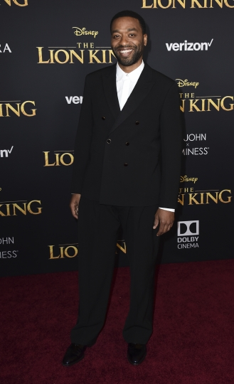 """Chiwetel Ejiofor arrives at the world premiere of """"The Lion King"""" on Tuesday, July 9, 2019, at the Dolby Theatre in Los Angeles. (Photo by Jordan Strauss/Invision/AP)"""