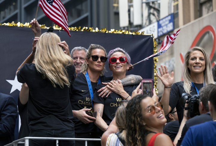 Members of the U.S. women's soccer team, including Megan Rapinoe, center and Julie Ertz, at right waving, celebrates during a ticker tape parade along the Canyon of Heroes, Wednesday, July 10, 2019, in New York. The U.S. national team beat the Netherlands 2-0 to capture a record fourth Women's World Cup title. (AP Photo/Craig Ruttle)