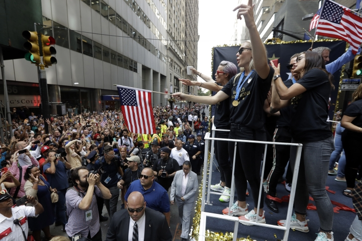 The U.S. women's soccer team, including Megan Rapinoe, far left on float, is celebrated with a parade along the Canyon of Heroes, Wednesday, July 10, 2019. in New York. The U.S. national team beat the Netherlands 2-0 to capture a record fourth Women's World Cup title. Wednesday, July 10, 2019. (AP Photo/Richard Drew)