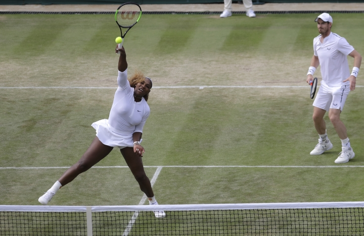 United States' Serena Williams and playing partner Britain's Andy Murray in action during a mixed doubles match against Unites States' Nicole Melichar and Brazil's Bruno Soares on day nine of the Wimbledon Tennis Championships in London, Wednesday, July 10, 2019. (AP Photo/Kirsty Wigglesworth)