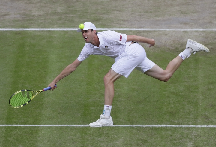 United States' Sam Querrey returns the ball to Spain's Rafael Nadal United States' Sam Querrey during a men's quarterfinal match on day nine of the Wimbledon Tennis Championships in London, Wednesday, July 10, 2019. (AP Photo/Kirsty Wigglesworth)
