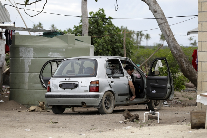 In this Sunday, April 7, 2019, photo, a man prepares to drive his car in Nuku'alofa, Tonga. China is pouring billions of dollars in aid and low-interest loans into the South Pacific, and even in the far-flung kingdom of Tonga there are signs that a battle for power and influence among much larger nations is heating up and could exact a toll. (AP Photo/Mark Baker)
