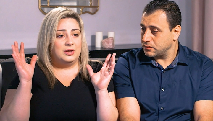 In this Monday, July 8, 2019 photo taken from video provided by Peiffer Wolf Carr & Kane, Anni and Ashot Manukyan describe their lawsuit against a fertility clinic during an interview in Los Angeles. The Southern California couple claim their embryo was mistakenly implanted in a New York woman, who gave birth to their son as well as a second boy belonging to another couple. The lawsuit by the Manukyans describes an alleged in vitro fertilization mix-up by CHA Fertility Center in Los Angeles that involves three separate couples. (Peiffer Wolf Carr & Kane via AP)