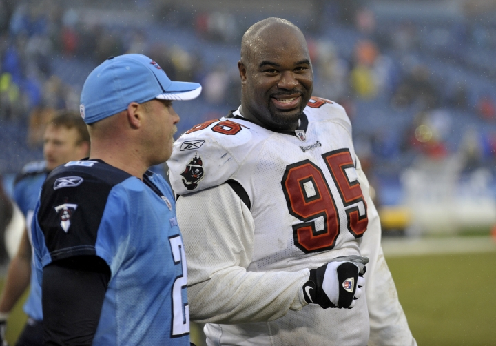FILE - In this Sunday, Nov. 27, 2011 file photo, Tampa Bay Buccaneers defensive tackle Albert Haynesworth (95) talks with former teammate Tennessee Titans kicker Rob Bironas (2) after an NFL football game in Nashville, Tenn. Former Tennessee Titans All-Pro defenseman Albert Haynesworth says on social media that he needs a kidney transplant. He shared a photo of himself in a hospital bed and wrote that his kidney failed him on Sunday, July 7, 2019 and he's looking for a donor.(AP Photo/Joe Howell, File)