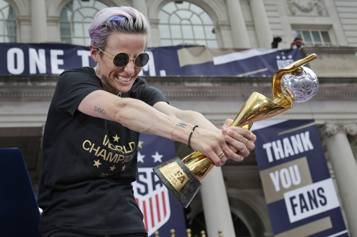 U.S. women's soccer player Megan Rapinoe celebrates with the FIFA Women's World Cup trophy at City Hall after a ticker tape parade, Wednesday, July 10, 2019 in New York. The U.S. national team beat the Netherlands 2-0 to capture a record fourth Women's World Cup title. (AP Photo/Seth Wenig)