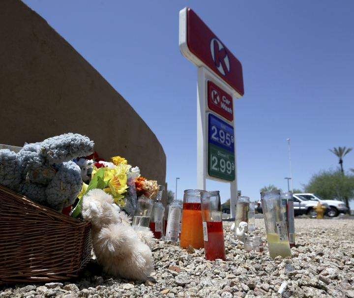 A makeshift memorial for Elijah Al-Amin is set up at a local Circle K store for the death of the stabbing victim Tuesday, July 9, 2019, in Peoria, Ariz. Peoria police arrested 27-year-old Michael Adams on suspicion of first-degree murder in the killing of 17-year-old Al-Amin, who was stabbed in his throat and back inside the store on July 4. Hundreds of people including a presidential candidate are speaking out on Twitter about the killing of a 17-year-old Muslim youth at a suburban convenience store by a white man who said he was threatened by the boy's rap music. (AP Photo/Ross D. Franklin)