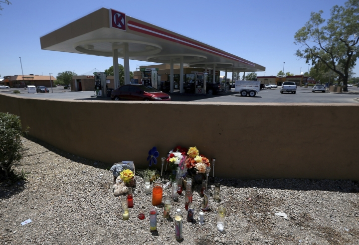 A makeshift memorial is set up for Elijah Al-Amin at a local Circle K store for the death of the stabbing victim Tuesday, July 9, 2019, in Peoria, Ariz. Peoria police arrested 27-year-old Michael Adams on suspicion of first-degree murder in the killing of 17-year-old Al-Amin, who was stabbed in his throat and back inside the store on July 4. Hundreds of people including a presidential candidate are speaking out on Twitter about the killing of a 17-year-old Muslim youth at a suburban convenience store by a white man who said he was threatened by the boy's rap music. (AP Photo/Ross D. Franklin)