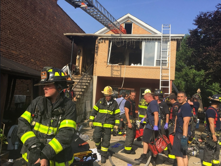 In this photo provided by the Fire Department of the City of New York, firefighters work the scene of a fatal house fire in the Queens borough of New York, Wednesday, July 10, 2019. Officials say that a 2-year-old girl died in the fire and two others were seriously injured. About 100 firefighters responded to the blaze. (FDNY via AP)