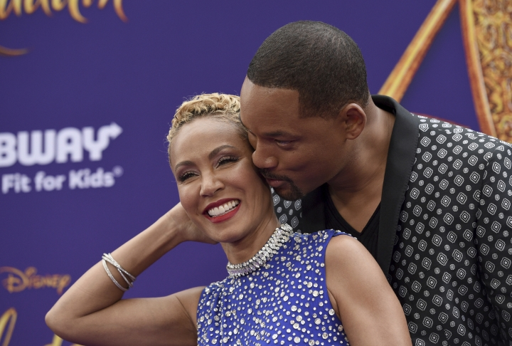 "FILE - In this May 21, 2019 file photo, Will Smith, right, kisses Jada Pinkett Smith as they arrive at the premiere of ""Aladdin"" at the El Capitan Theatre in Los Angeles. The Hollywood power couple on Wednesday announced the launch of a new media venture. According to a statement, Westbrook Inc. will be a cross-platform holding company ""formed to execute the Smith family's global content and commerce business strategy."" (Photo by Chris Pizzello/Invision/AP, File)"