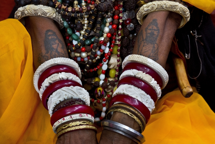 In this June 26, 2019 photo, a sadhvi, or Hindu holy woman, sits with her hands tattooed with images of Hindu god Shiva during Ambubachi festival at the Kamakhya temple in Gauhati, India. The temple is presided over by the goddess Kamakhya, the most important goddess of tantric worship, an esoteric form of Hinduism. The four-day Ambubachi festival is a celebration of Kamakhya's yearly menstrual cycle, and it brings hundreds of thousands of devotees to the temple. (AP Photo/Anupam Nath)