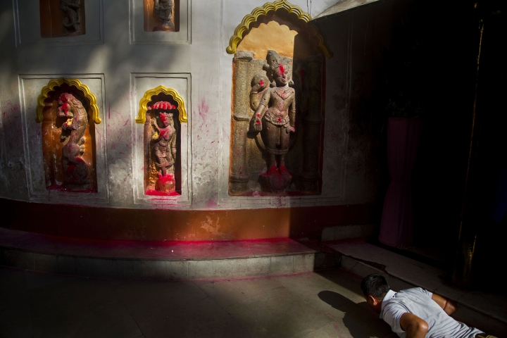 In this June 23, 2019 photo, a devotee offers prayers in front of idols of goddess kamakhya during Ambubachi festival at the Kamakhya temple in Gauhati, India. The temple is presided over by the goddess Kamakhya, the most important goddess of tantric worship, an esoteric form of Hinduism. The four-day Ambubachi festival is a celebration of Kamakhya's yearly menstrual cycle, and it brings hundreds of thousands of devotees to the temple. (AP Photo/Anupam Nath)