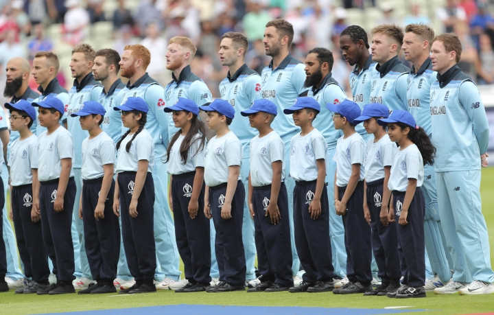 England players stand for their national anthem before the start of the Cricket World Cup semi-final match between England and Australia at Edgbaston in Birmingham, England, Thursday, July 11, 2019. (AP Photo/Aijaz Rahi)